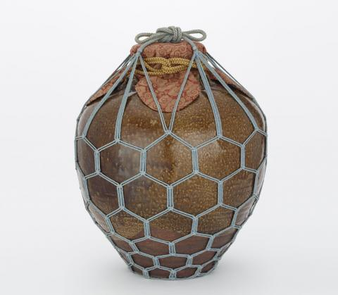 Chigusa dressed in its net bag and mouth cover
